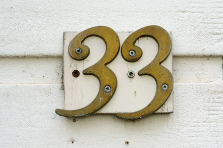 cast metal type: Brass house number thirty three (33)