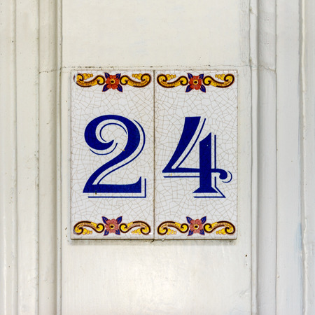 Ordinal: house number twenty four (24) on two ceramic tiles Stock Photo