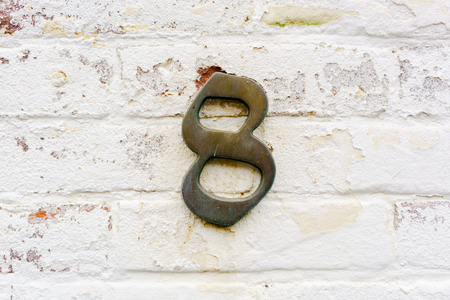 cast metal type: Bronze house number eight (8)