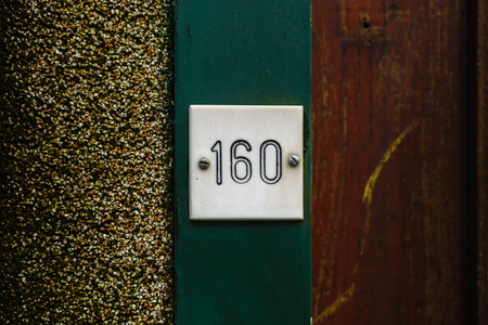 Ordinal: House number one hundred and sixty (160) engraved in plastic