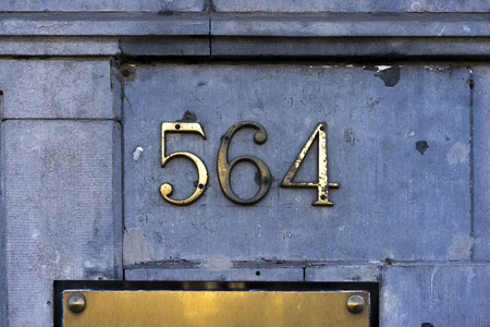 cast metal type: House number five hundred sixty four (564) Stock Photo