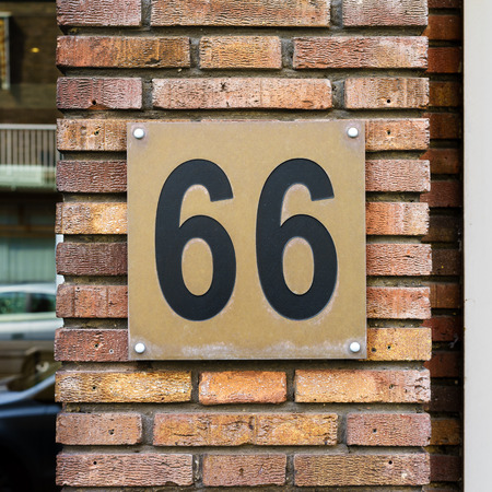 cast metal type: House number sixty six (66)