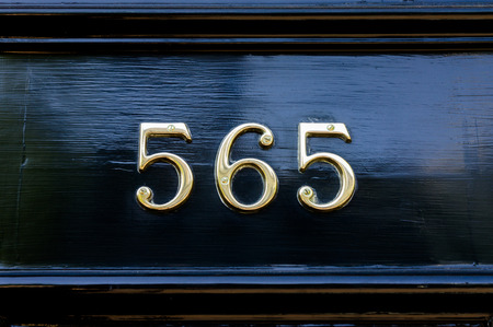 cast metal type: House number five hundred and  sixty five (565)