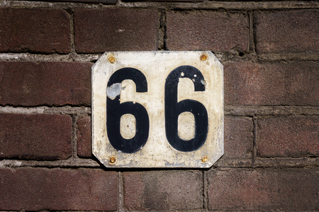 sixty: House number sixty six (66)