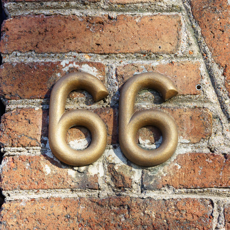 identical: House number sixty six (66)