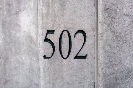House number five hundred and two (502) engraved in stone