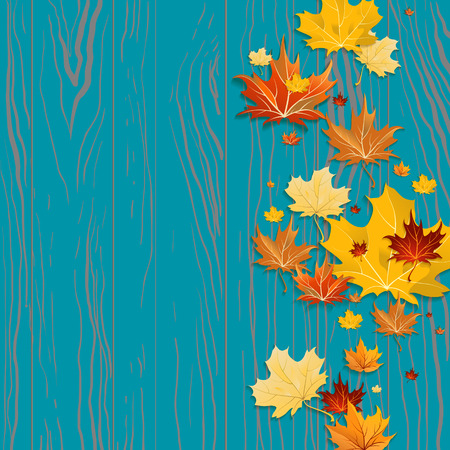 Maple leaves on wood background with place for text.