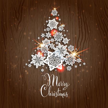 decors: Christmas tree on wood background. Holiday decoration.