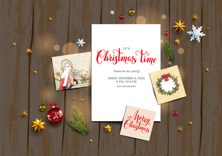 Holiday card with festive card and decorations balls, stars, snowflakes on wood background. Christmas festive template.