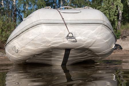choppy: Empty inflatable boat in choppy water