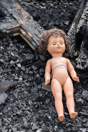 devastation: Old toy doll in the midst of ruins and devastation. Stock Photo