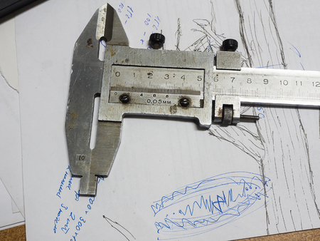 micrometer: Old caliper and Micrometer on technical drawings.