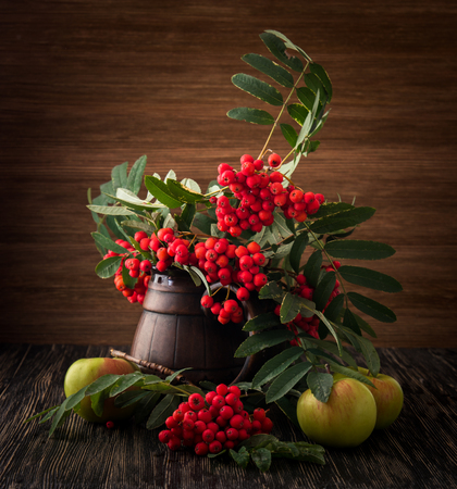 vase of flowers: Painting. Still life with vase, flowers, fruit, rowan on wood background. It can be used to create packages, gift cards and design.