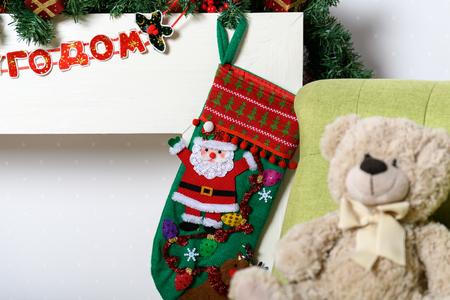 Teddy bear in a chair under the Christmas tree