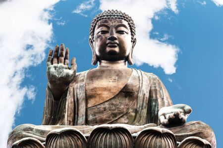 Buddha image in Polin temple in Hong Kong with blue sky
