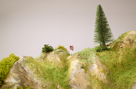 Little toys with model mountain. Close up photo.