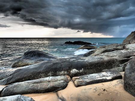 breaking through: Sun breaking through the stormclouds before rain.