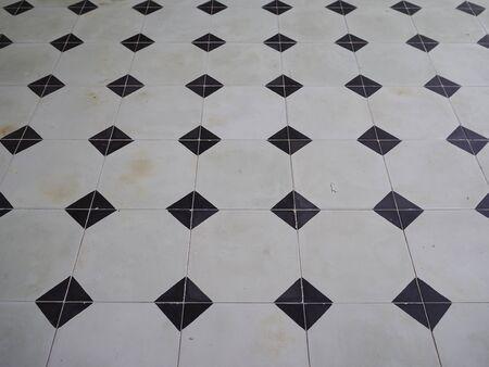 tiled floor: Close up Black and White Tiled floor