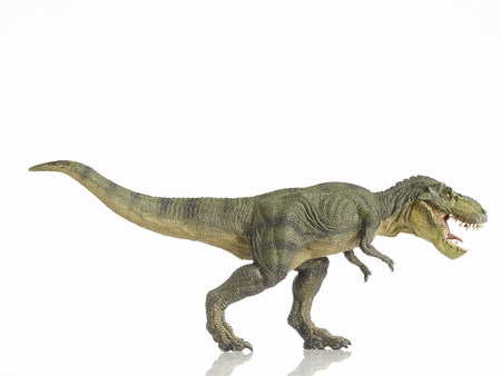 Isolated dinosaur and monster model in white