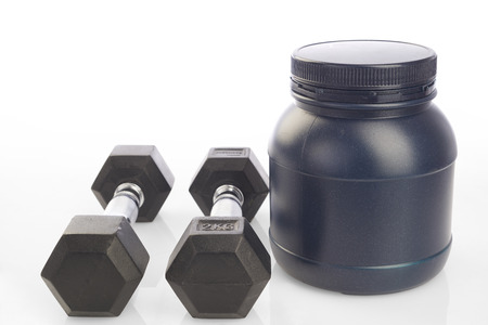 Isolated two dumbbells and protein powder bottle on white background Stock Photo