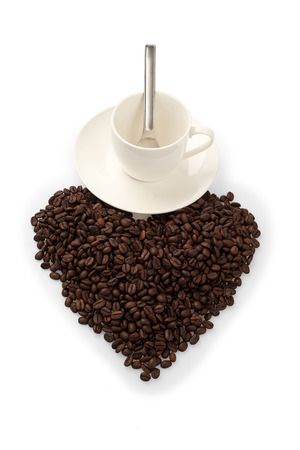 cup with coffee beans in shape heart