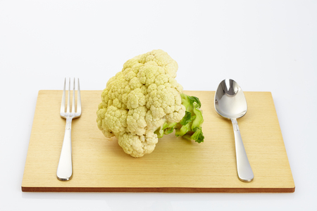 fresh cauliflower on wooden table in white background Stock Photo