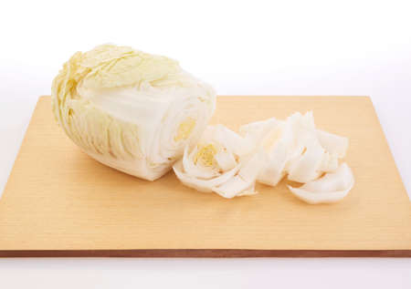 shooting fresh white cabbage on cutting board