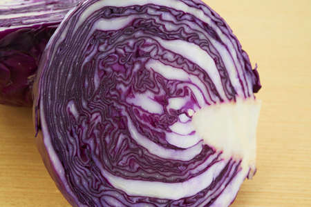 close up fresh purple cabbage on cutting board