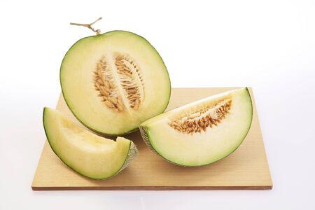 melon fruit: shooting melon fruit on cutting wooden board
