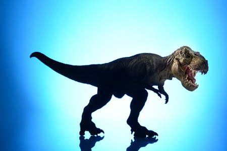 shooting dinosaur model on blue background