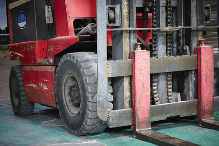 dry provisions: Forklift loader with pallet in distribution warehouse