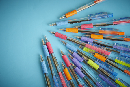ball pen: shooting different kinds of pens isolated on blue background Stock Photo