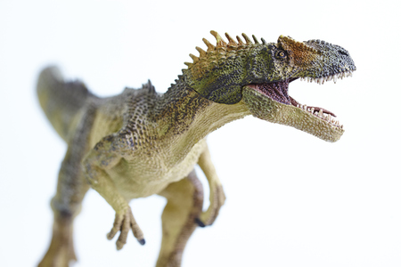 shooting dinosaur model on white background Stock Photo