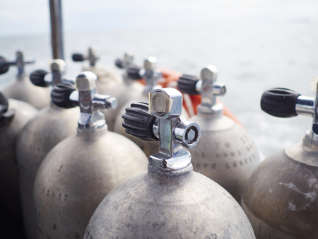 oxigen: Row of oxigen tanks for scuba diving. Stock Photo
