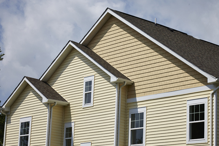 family units: Residential house with cream siding Stock Photo