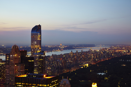 New York City Manhattan aerial view at dusk with urban city skyline and skyscrapers buildings