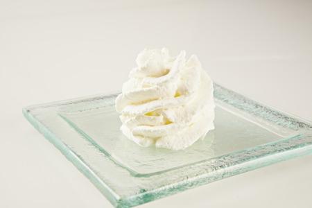 skim: close up of whipped cream on white background