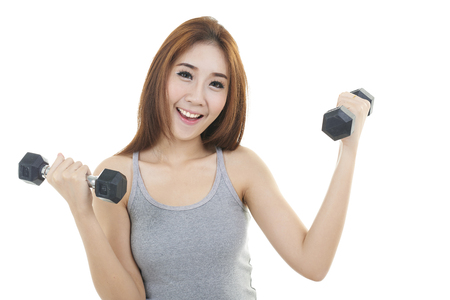 women sport: happy young woman exercising with dumbbells