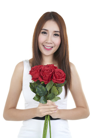women s health: portrait of attractive pretty asian woman isolated on white studio shot with red rose Stock Photo