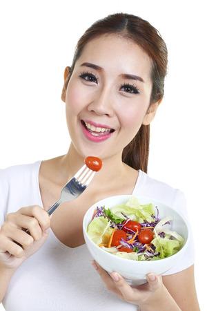 eating salad: Beautiful smiling woman having a healthy breakfast