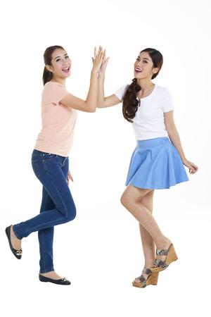 Portrait of happy young women with white background Zdjęcie Seryjne