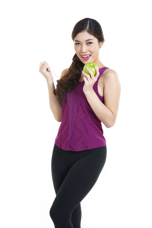 asian abs: Beautiful smiling woman having a healthy breakfast