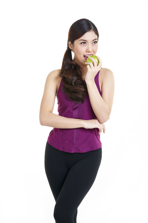 lady in red: Beautiful smiling woman having a healthy breakfast