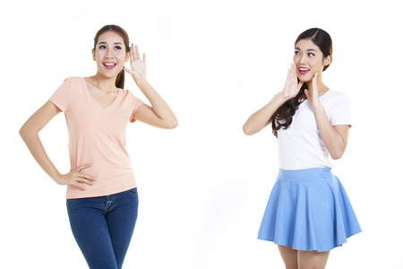 teen love: Portrait of happy young women with white background Stock Photo