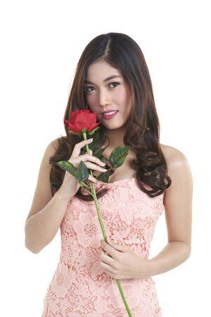 portrait of attractive pretty asian woman isolated on white studio shot with red rose Lizenzfreie Bilder
