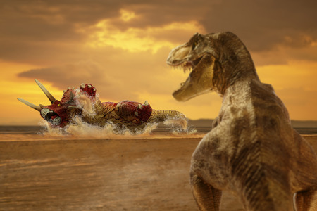 dinosaur scene of the two dinosaurs fighting each Stock Photo