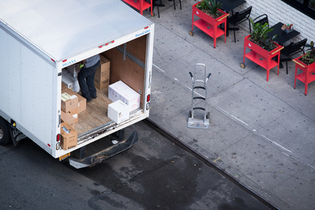delivery man courier standing near the white truck. Shipping service.