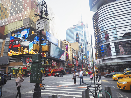 adds: NEW YORK, USA - November 17, 2016.  Times Square  at Night and LED Advertising Lighting up the Place in Manhattan, New York Editorial