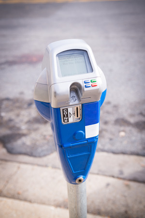 expiring: Machine parking on a city street Stock Photo
