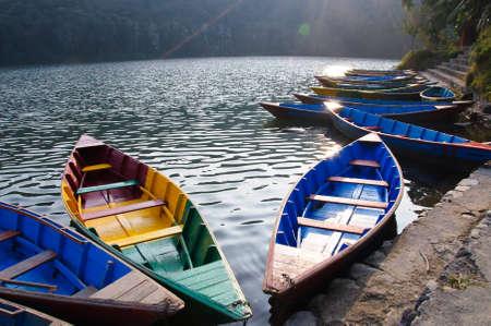 Pleasure boats at Fewa lake in Pokhara,Nepal photo